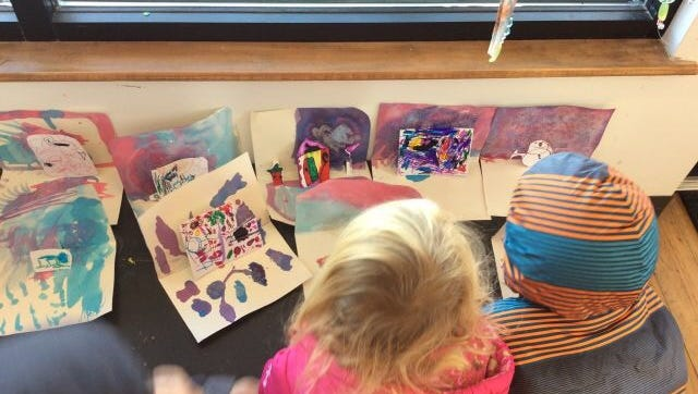 Make pop-up cards with a variety of mediums. Here, students started by watercoloring paper.