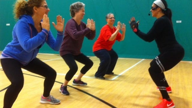 """(From left) Jen Smith, Wendi Wolfe and Margarita Rivera, being led by instructor Donna Ocasio during a Zumba """"Turkey Burner"""" class in the YMCA's Milam Family Center in Vineland."""