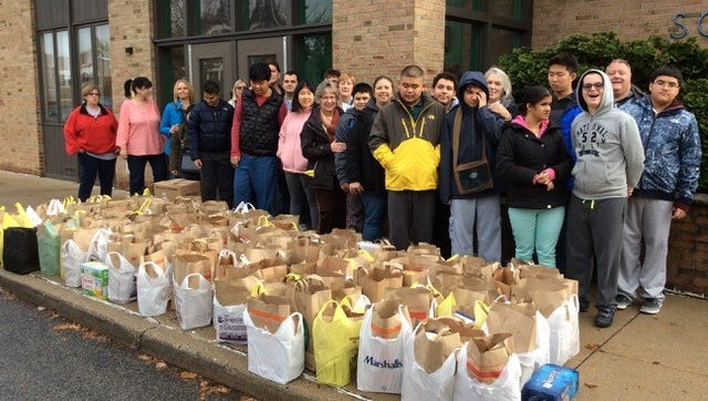 Students with autism at The Forum School are working hard to make sure that friends and neighbors will not go hungry this winter.