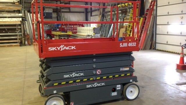 New scissor lift at JVS Garage Door in Port Clinton will make jobs safer.
