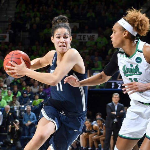 Connecticut guard Kia Nurse (11) drives to the basket as Notre Dame forward Brianna Turner (11) defends in the second quarter.