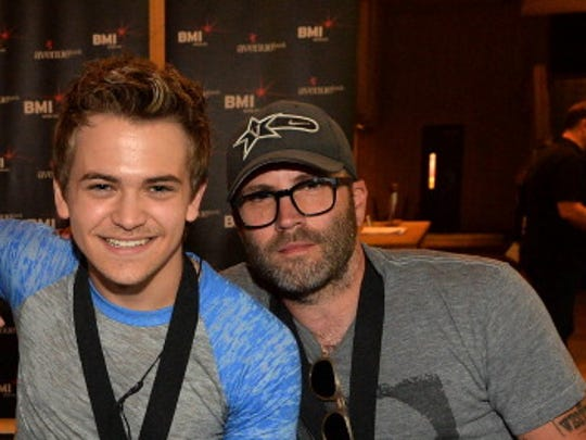 "Co-writer Luke Laird, Hunter Hayes and co-writer Andrew Dorff attend No. 1 song celebration for ""Somebody's Heartbreak"" at BMI on June 25, 2013, in Nashville."
