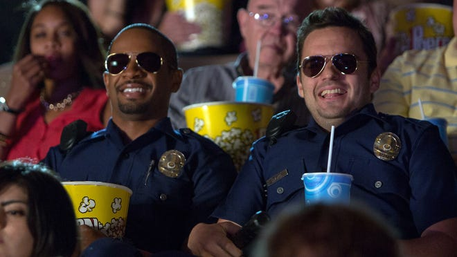 "Daman Wayans Jr., left, and Jake Johnson go to the movies for laughs in ""Let's Be Cops,"" and so will many audiences this summer with a broad range of comedies to check out."