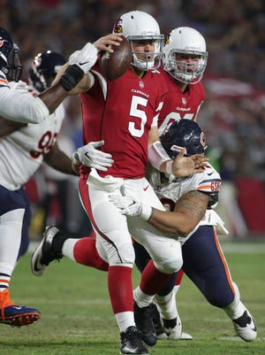 Arizona Cardinals quarterback Drew Stanton (5) is sacked by Chicago Bears defensive end Jonathan Bullard, right, during the first half of a preseason NFL football game, Saturday, Aug. 19, 2017, in Glendale, Ariz.