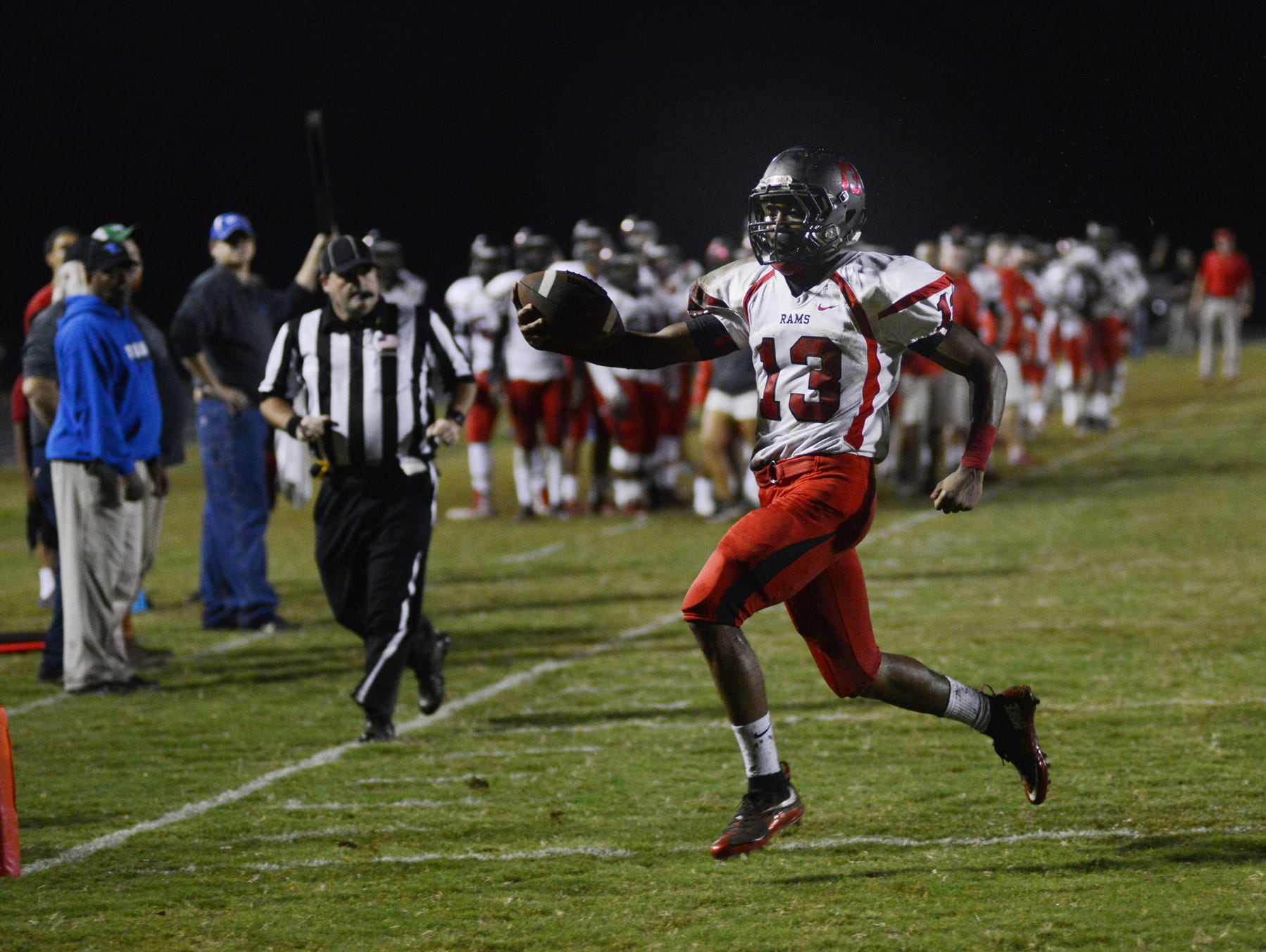 Hillcrest High's Brandon Peppers (13) scores a touchdown at Whitt Memorial Field against Woodmont High School on Friday.
