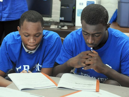In this 2013 file photo, Sha-Quan Bailey and Maurice Thomas prepare to write about their goals for the future during a Junior Achievement workshop at the Family Partnership Center in Poughkeepsie. Thomas and Bailey participated in the Family Services' Summer Youth Employment Program.