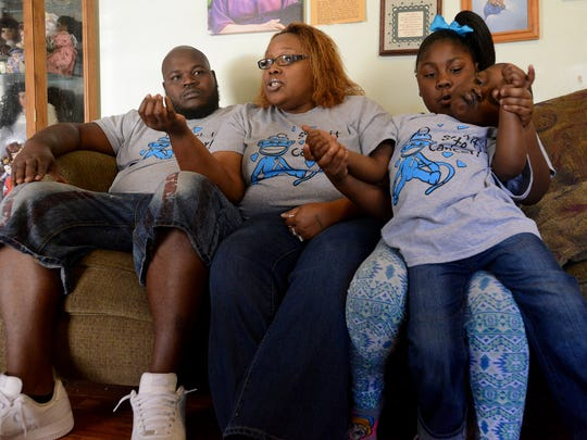 Kendalyn Thomas plays with her little brother, 3-year-old Kyson, while their parents talk about the procedure and process of Kyson's recovery. Kyson had surgery at St. Jude Children's Research Hospital in Memphis to remove a tumor on his brainstem.