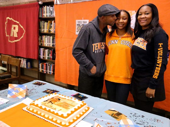 Riverdale's Anastasia Hayes poses with her parents Arnett and Sherry Hayes after signing with Tennessee earlier this season.