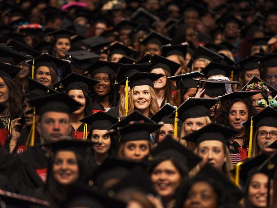 Graduates look toward the stage during the Montclair State University Commencement Ceremony at the Prudential Center in Newark on May 25th, 2017.