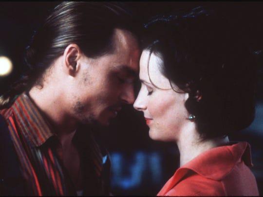 "Johnny Depp and Juliette Binoche star in Miramax Films' ""Chocolat."""