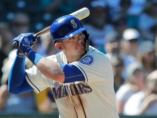 Seattle Mariners' Ryon Healy begins his swing on a