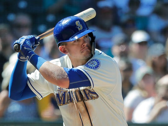 Seattle Mariners' Ryon Healy begins his swing on a three-run home run in the eighth inning of a baseball game against the Chicago White Sox, Sunday, July 22, 2018, in Seattle. The Mariners won 8-2. (AP Photo/Ted S. Warren)