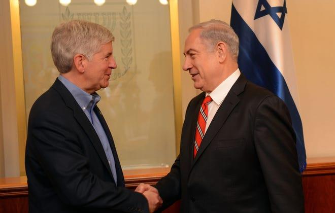 Israeli Prime Minister Benjamin Netanyahu greets Michigan Gov. Rick Snyder in Jerusalem, June 17, 2013.
