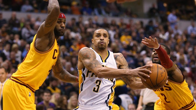 Cleveland Cavaliers forward LeBron James and teammate Kyrie Irving can't stop Indiana Pacers guard George Hill on a spirited drive to the basket in the fourth quarter. The Pacers hosted Cleveland at Bankers Life Fieldhouse Friday, February 6, 2015.