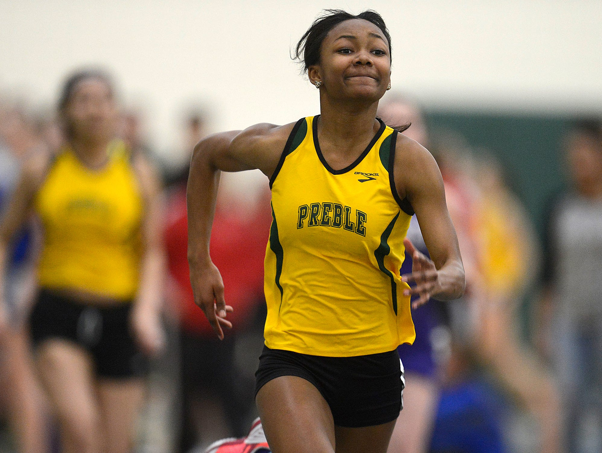 Green Bay Preble's Shai' Deja Cooper races towards the finish line while competing in the 45 meter dash during the 16th annual Preble Indoor Invitational at Green Bay Preble High School on Wednesday, March 18, 2015.