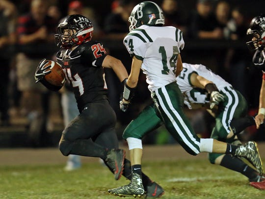 Ludlow running back Sean Stratton runs for a huge gain