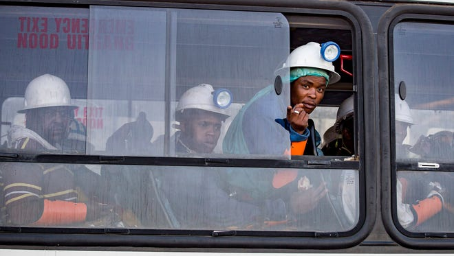 Miners who were trapped underground are transported to a safe holding area after being trapped underground at the Sibanye Stillwater's Beatrix mine, Welkom, South Africa, Feb. 2, 2018.