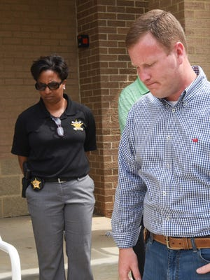 Chad McBride, right, Anderson County Sheriff, finishes a press conference near spokeswoman Nikki Carson, left, after talking about the death of one of his deputies, Devin Hodges during a press conference at North Anderson Baptist Church in Anderson on Thursday.