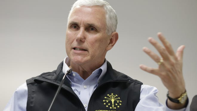 In Gov. Mike Pence answers a question at a news conference earlier this year.