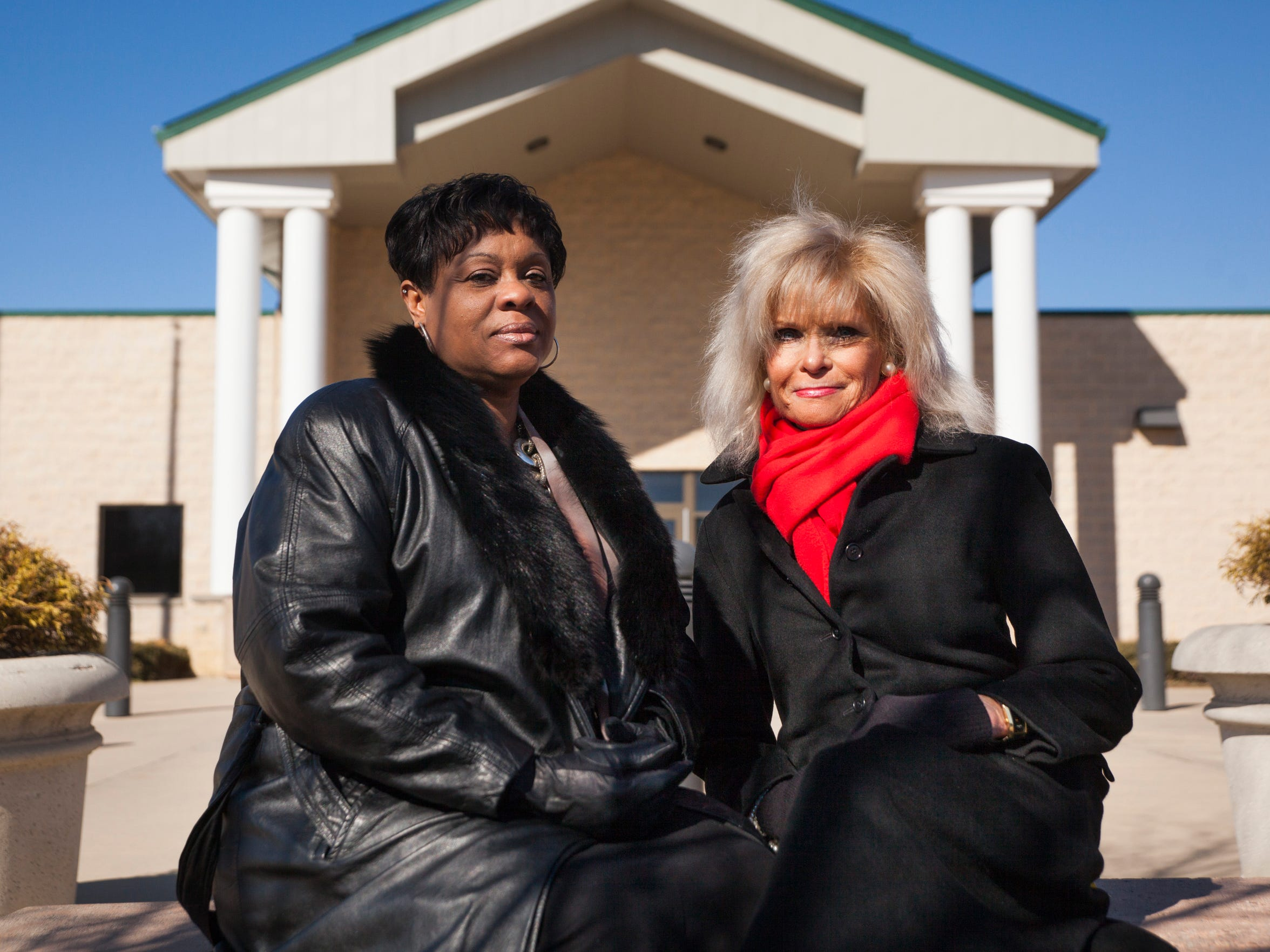 T-Ann Johnson, left, and Nancy Insco, who helped developed a pre-release re-entry program for women inmates at Middle River Regional Jail, sit outside the adult detention center in Verona on Feb. 15.