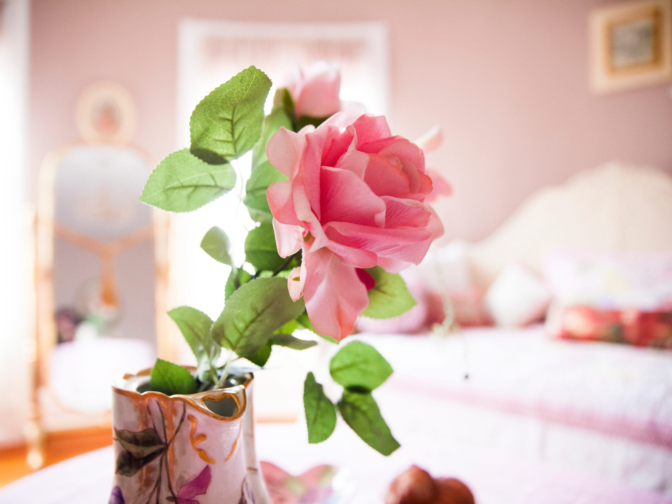 A rose sits inside one of the bedrooms at the Berkeley House Bed and Breakfast on Tuesday, March 24, 2015.