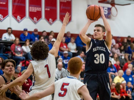 Marysville's Ross Hinkley takes a shot during a basketball game Friday, Dec. 9, 2016 at St. Clair High School.