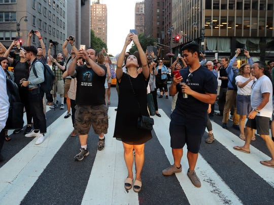 Thousands stand on 42nd Street and on many cross streets