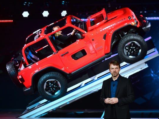 Mike Manley, who heads the Jeep and Ram brands for Fiat Chrysler Automobiles, introduces the new 2018 Jeep Wrangler during the Los Angeles Auto Show, Nov. 29, 2017, in Los Angeles.