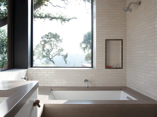 Classic white subway tile gives a bathroom a fresh, warm appeal.