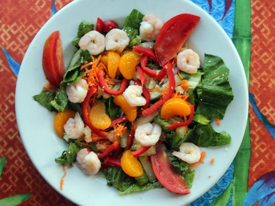 Chef Tom's Asian shrimp salad is an original - a popular lighter dish that consists of grilled shrimp with red peppers, cucumber, red onion, pineapple, mandarin orange and salsa done with a sesame ginger dressing.