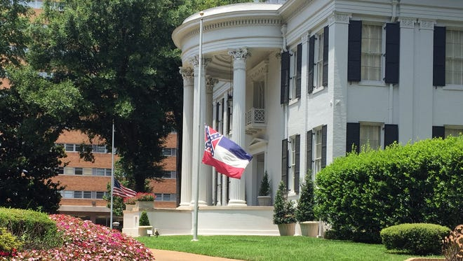 Flags fly at half-staff in this 2015 photo of the Governor's mansion in Jackson, Miss.