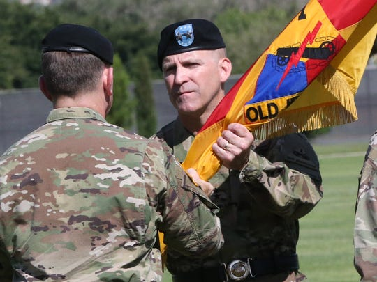 """Maj. Gen. Robert """"Pat"""" White, pictured assuming command of Fort Bliss last year, is among 400 post soldiers deploying to Iraq."""