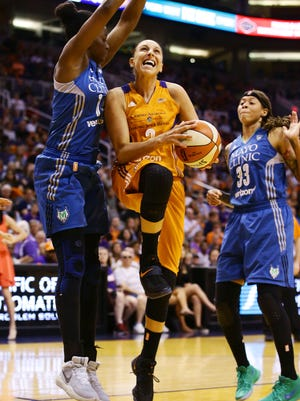 Phoenix Mercury guard Diana Taurasi drives to the basket and scores against the Minnesota Lynx on Friday, June 30, 2017 at Taking Stick Resort Arena in Phoenix, Ariz.