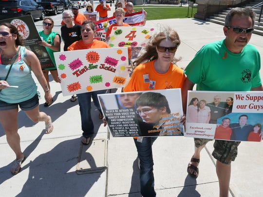 Brendan Dassey's mother and stepfather Barb and Scott Tadych, right, participate in the pro-Dassey and Steven Avery rally at the Manitowoc County Courthouse on Saturday, June 11. Avery and his nephew, Dassey, were convicted in 2007 of killing freelance photographer Teresa Halbach.