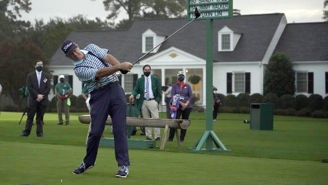 Sandy Lyle hits the first shot of the day of No. 10 Thursday morning in the opening round of the Masters Tournament. The former champion added a set of suspenders to his outfit for the day.