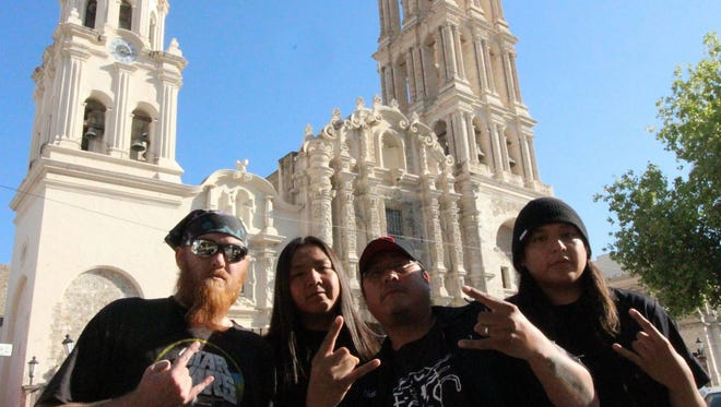 The members of Signal 99 pose before the Santiago Cathedral in Saltillo, Mexico, during a trip there in October for a show. The Shiprock metal band will return to Mexico for two performances in May.