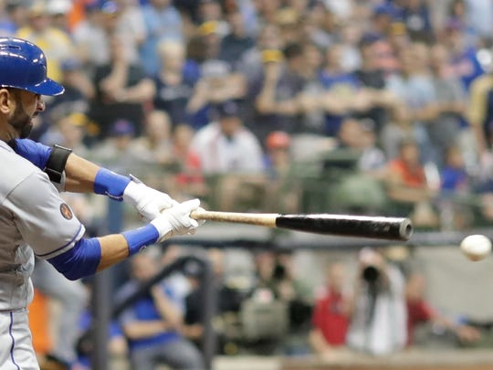 New York Mets' Jose Bautista hits an RBI single during the ninth inning of a baseball game against the Milwaukee Brewers Friday, May 25, 2018, in Milwaukee.