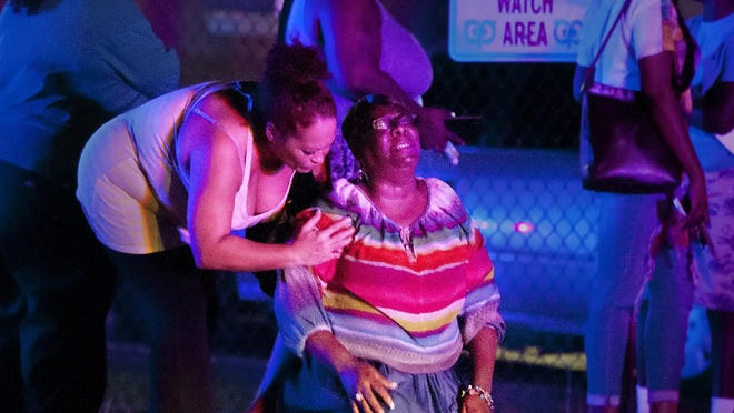 Jessie Strong collapses after learning her son, Devon Strong, was killed Wednesday night in a shooting at the Sunrise Towers Apartments at Royal Palm Avenue and Linhart Avenue in Fort Myers.