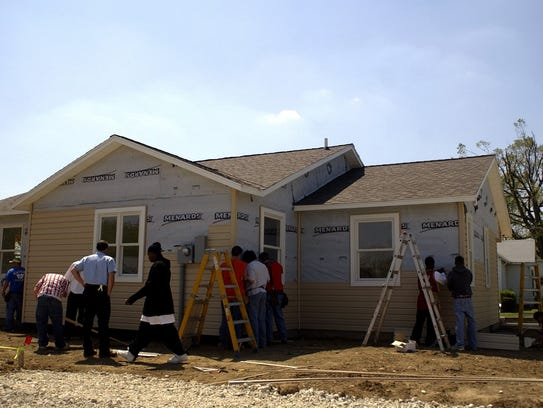 Career Center students work on building a house at