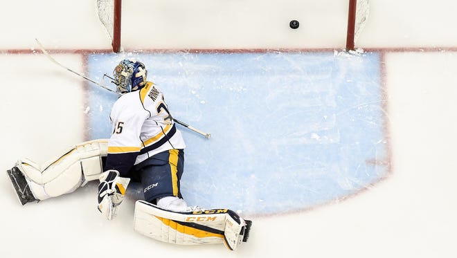 Nashville Predators goalie Pekka Rinne (35) fails to stop a goal scored by Pittsburgh Penguins center Jake Guentzel (59) during the third period in game two of the Stanley Cup Final at PPG Paints Arena in Pittsburgh, Pa., Wednesday, May 31, 2017.