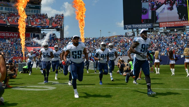 The Tennessee Titans take the field before a preseason NFL game against the Carolina Panthers at Nissan Stadium in Nashville, Tenn., Saturday, Aug. 19, 2017.