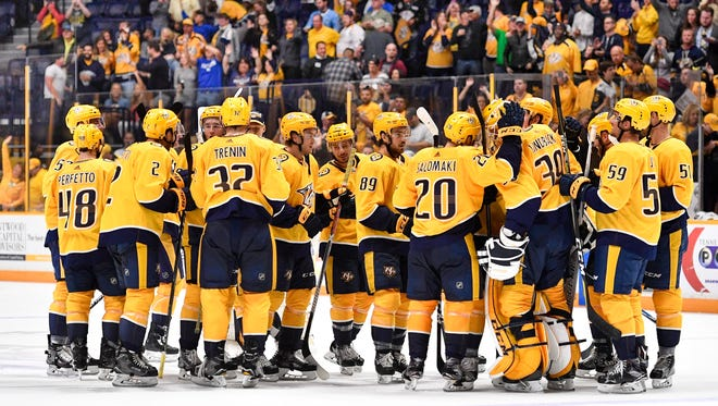 The Predators celebrate their victory against the Florida Panthers during overtime in the second game of a preseason doubleheader Tuesday, Sept. 19, 2017, at Bridgestone Arena.
