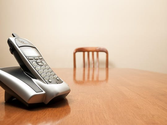 Modern cordless phone sitting on a table