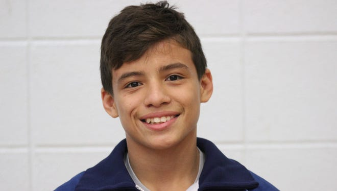 Enka senior Melvin Rubio has committed to wrestle in college for Queens.