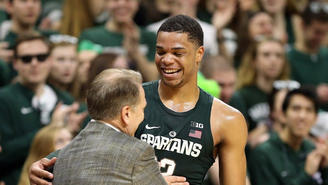 Michigan State coach Tom Izzo jokes with Miles Bridges late in the Spartans' 88-72 win over Nebraska on Feb. 23, 2017 in East Lansing.