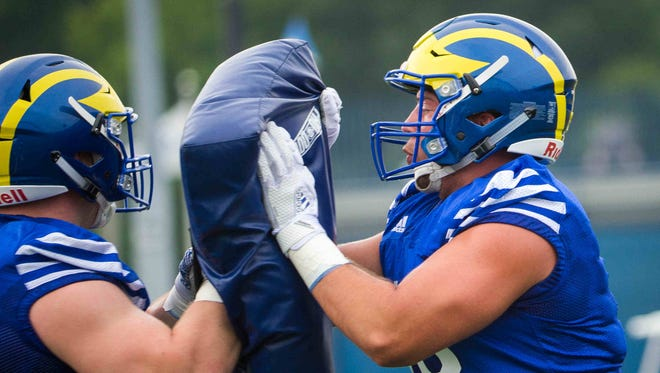 Delaware tight end Kyle Yocum (right) runs through drills during practice.