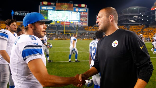Lions quarterback Matthew Stafford and Steelers quarterback Ben Roethlisberger meet on the field following an exhibition game in Pittsburgh, Aug. 12, 2016.
