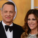 """Tom Hanks and wife actress Rita Wilson as they attend the 20th annual Screen Actors Guild Awards at the Shrine Auditorium in Los Angeles in January. Wilson revealed that she had a double mastectomy following a breast cancer diagnosis, People Magazine reported April 14, 2015. """"Last week, with my husband by my side, and with the love and support of family and friends, I underwent a bilateral mastectomy and reconstruction for breast cancer after a diagnosis of invasive lobular carcinoma,"""" Wilson told the magazine."""