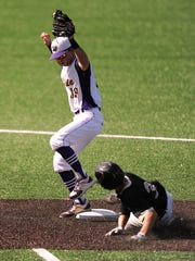 Wylie shortstop Zach Smith (39) forces out Pleasant Grove baserunner Cade Thompson (3) during the top of the sixth inning of the Bulldogs' 3-1 win over Texarkana Pleasant Grove in the Class 4A UIL state baseball semifinal on Wednesday, June 7, 2017, at Disch-Falk Field in Austin.