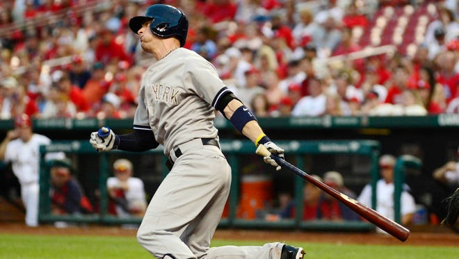 Yankees first baseman Brendan Ryan drives in a run with a single in the 12th inning during a 6-4 win over the Cardinals on Monday.